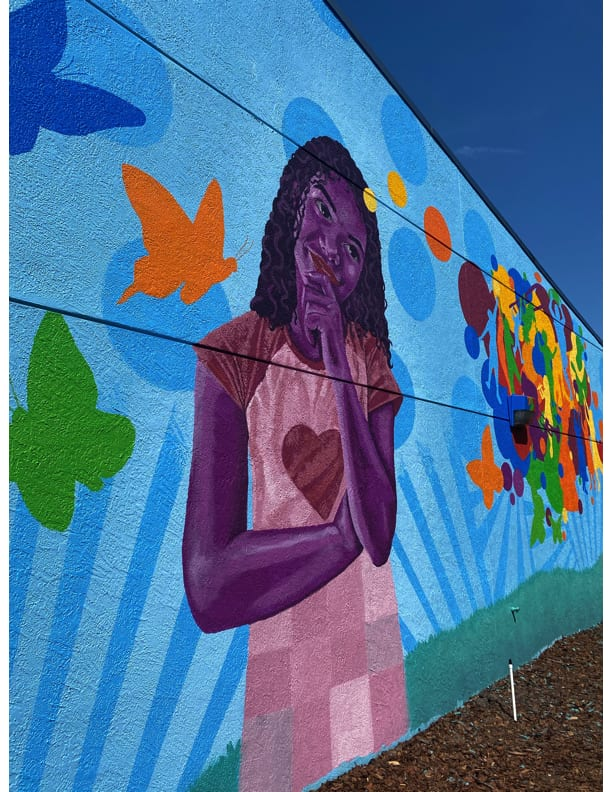 A colorful mural by artist Zulu Painter was unveiled Friday at the North Greenwood Recreation Center in Clearwater.