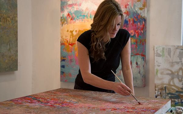 Amy Donaldson painting in her studio